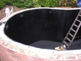 Kidney shaped pond fibreglassed by GRP photo 7