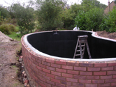 Kidney shaped pond fibreglassed by GRP photo 9