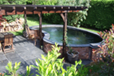Kidney shaped pond fibreglassed by GRP photo 11
