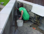 A Koi pond being fibreglassed by GRP